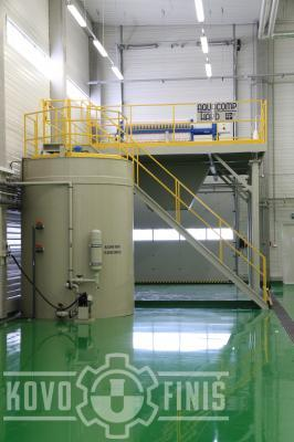Filter press with a sludge water storage tank